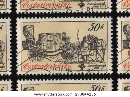 "CZECHOSLOVAKIA - CIRCA 1981: A used postage stamp printed in Czechoslovakia from the ""Historic Coaches in Postal Museum"" issue, shows coachmen preparing to harness a horse to a coach. - stock photo"