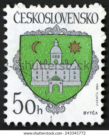 CZECHOSLOVAKIA - CIRCA 1990: post stamp printed in Ceskoslovensko (Czech) shows coat of arms of regional capitals; city Bytca; Slovakia; castle moon star on shield; Scott 2784 50h green, circa 1990 - stock photo