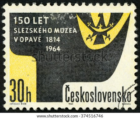 CZECHOSLOVAKIA - CIRCA 1964: post stamp printed in Ceskoslovensko (Czech) shows Silesian coat of arms; 150th anniversary of Silesian museum, Opava; Scott 1248 A475 30h black yellow, circa 1964 - stock photo