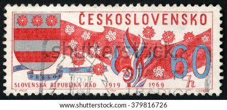 CZECHOSLOVAKIA - CIRCA 1969: post stamp printed in Ceskoslovensko shows arms of Presov Slovakia, banner & blossoms (1919-1969); Scott 1614 A600 60h red silver blue, circa 1969 - stock photo