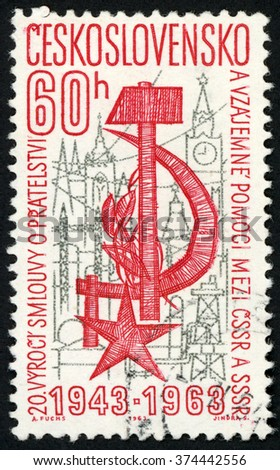 CZECHOSLOVAKIA - CIRCA 1963: post stamp printed in Ceskoslovensko shows star, hammer, sickle & city; 20th anniversary Russia Czech treaty; Scott 1209 A464 60h red, circa 1963 - stock photo