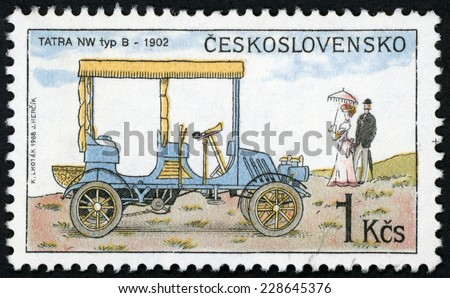 CZECHOSLOVAKIA - CIRCA 1988: post stamp printed in Czech (Ceskoslovensko) shows 1902 Tatra NW Type B and people; classic automobiles; Scott 2692 A967 blue yellow 1k, circa 2008 - stock photo
