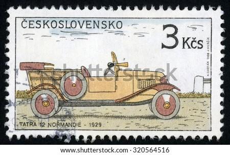 CZECHOSLOVAKIA - CIRCA 1988: post stamp printed in former Czechoslovakia (Ceskoslovensko) shows historic motor car 1929 Tatra 12 Normandie; classic automobiles; Scott 2694 A967 3k; circa 1988 - stock photo