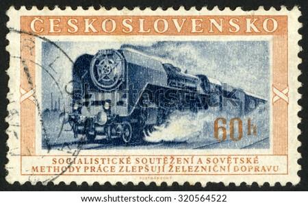 CZECHOSLOVAKIA - CIRCA 1953: post stamp printed in former Czechoslovakia (Ceskoslovensko) shows locomotive; Scott 633 A260 60h brown orange gray; circa 1953 - stock photo