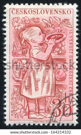 CZECHOSLOVAKIA - CIRCA 1960: stamp printed by Czechoslovakia, shows Child eating pie, circa 1960 - stock photo