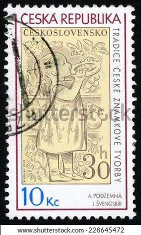 CZECHOSLOVAKIA - CIRCA 2009: stamp printed in (Ceska, Ceskoslovensko) shows little girl eating cake, 2 bees flying; tradition of Czech stamp production; Podzemna, Svengsbir; Scott 3410 10k, circa 2009 - stock photo