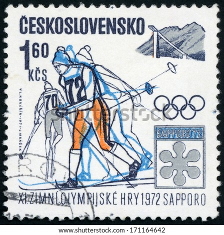 CZECHOSLOVAKIA - CIRCA 1972: stamp printed in Czech (Czechoslovakia) shows Olympic emblems and skier women;  11th winter Olympic games, Sapporo, Japan; Scott 1799 A647 1.60k orange blue, circa 1972