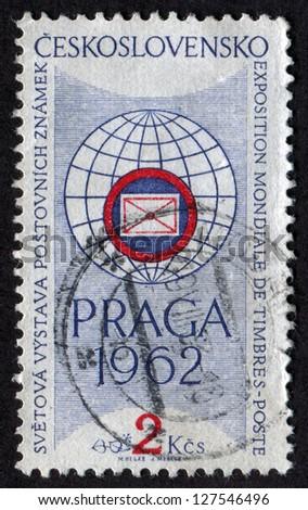 CZECHOSLOVAKIA - CIRCA 1961: stamp printed in Czech Republic shows Exhibition Emblem. �Praga 1962� International Stamp Exhibition. Scott Catalog 1030 A402 2k blue & red, circa 1961. - stock photo