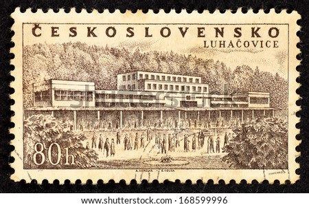 CZECHOSLOVAKIA - CIRCA 1958: Stamps printed in Czechoslovakia with image of a bath spa complex in the spa town of Luhacovice in the Zia­n Region, Moravia, Czechoslovakia, circa 1958.  - stock photo