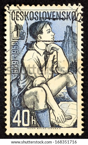 CZECHOSLOVAKIA - CIRCA 1959: Stamps printed in Czechoslovakia with image of male student with compass and map on outdoor exploration activity, circa 1959.