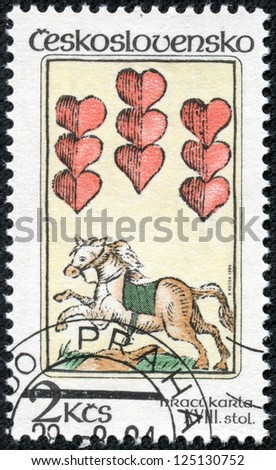 CZECHOSLOVAKIA - CIRCA 1984: The stamp printed in Czechoslovakia shows a horse and hearts, circa 1984 - stock photo