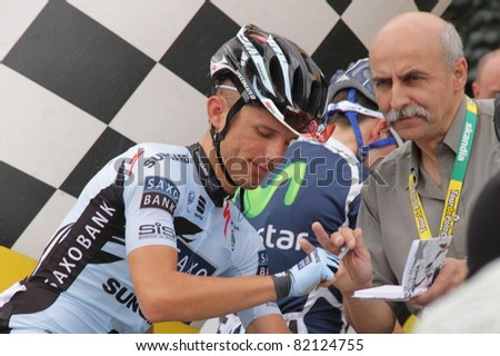 CZESTOCHOWA, POLAND - AUGUST 1 - Rafal Majka (Saxo Bank SunGard) signs an autograph just before the second stage of the Tour de Pologne 2011, on August 1,2011 in Czestochowa, Poland - stock photo