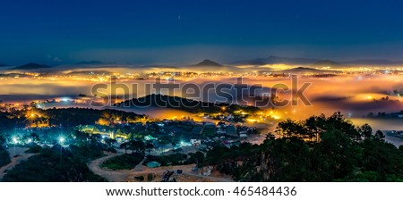 Da Lat City by night in 18 July 2016. Da Lat City in the mist magical night, hiden in the fog and clouds. Da Lat is a famous city for travel in Vietnam. City Of love and flowers.