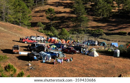 DA LAT, VIET NAM- JAN 2: Group of person in family vacation in spring, people with 4x4 terrain car camp at pine forest, exciting experience in eco travel with tent, Dalat, Vietnam, Jan 2, 2016