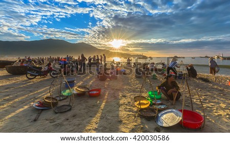 Da Nang, Vietnam, June 26th, 2015: Market fishing when people busy buying selling fish, transport fish, sun rays radiating prepared atmosphere very lively, all living life in Da Nang, Vietnam