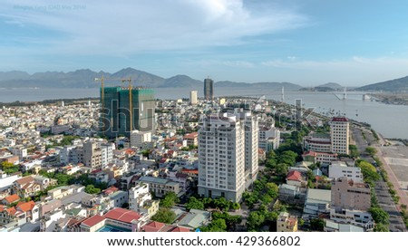 Da Nang, Vietnam - May 24, 2016: Business and Administrative District of Da Nang city on the Han riverbank, with Thuan Phuoc Bridge. Picture taken on May 24, 2016