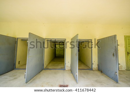Dachau, Germany - July 30, 2015: Heavy metal doors leading into the krematorium building at concentration camp.