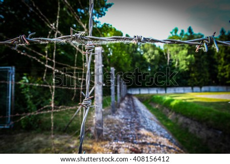 Dachau World War II Concentration in Germany Camp (Ditch and fence, Dachau Concentration Camp, near Munich, Bavaria, Germany, Europe) - stock photo
