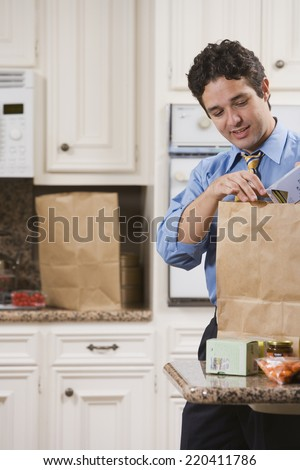 Dad after Work with Toddler and Groceries - stock photo