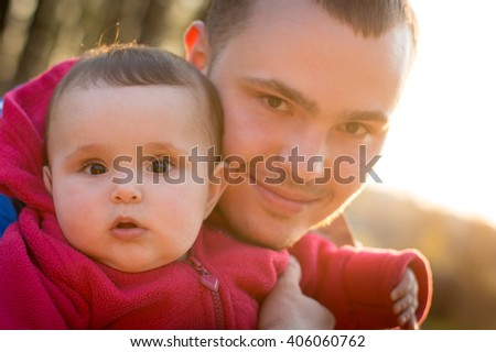 Dad and baby daughter portrait - stock photo