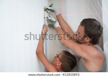 Dad and boy son work together at home