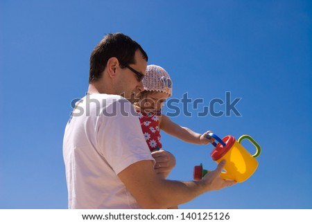 Dad and daughter spending a day at the beach - stock photo