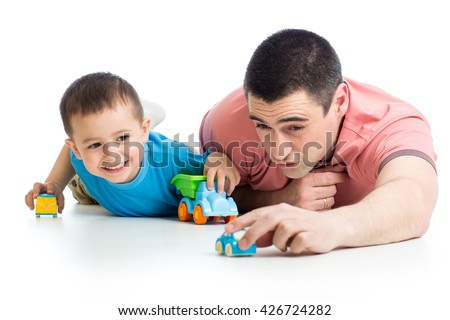 Dad and little child boy playing with toy cars
