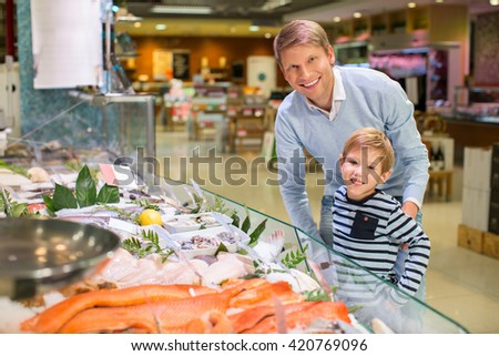 Dad and son in a store - stock photo