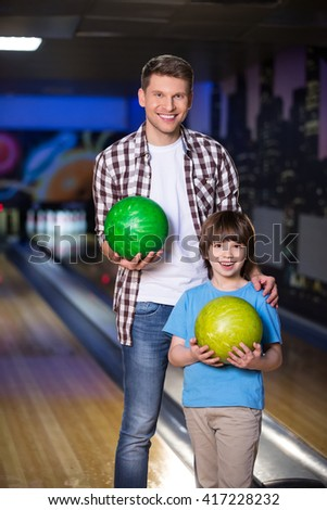 Dad and son in bowling  - stock photo
