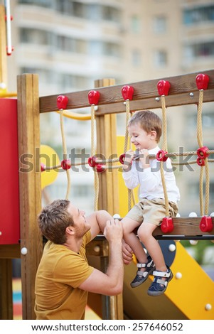 Dad and son on the playground - stock photo