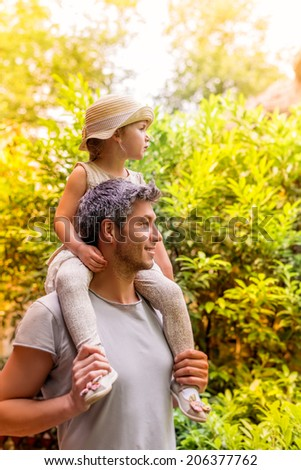 dad enjoying freetime outdoor with little cute girl - stock photo