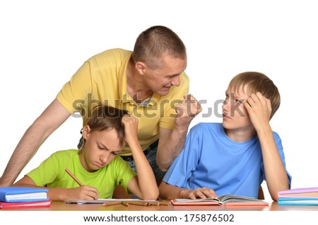 dad helping children with their homework on a white background - stock photo