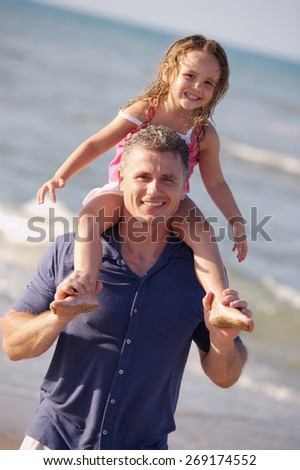 Dad is fun at the Beach - stock photo