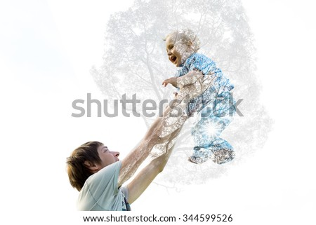 Dad picks up her son as the tree grows. Double Exposure - stock photo