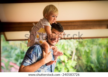 dad play with his blonde baby daughter - stock photo