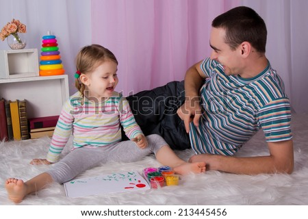 Dad playing with child at home, construction of a constructor
