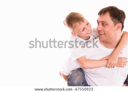 dad playing with his son - stock photo