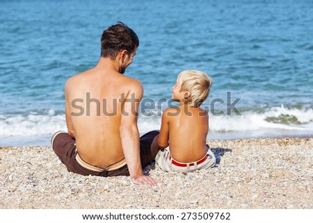 Dad, son, beach. - stock photo