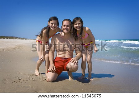 Dad with daughters - stock photo