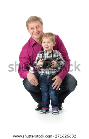 Dad with his son and a camera. Isolate on white. - stock photo
