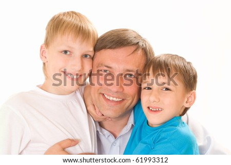dad with his sons in white on a white background - stock photo
