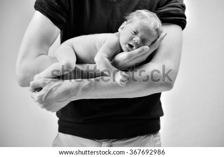 Dad with new born baby - stock photo
