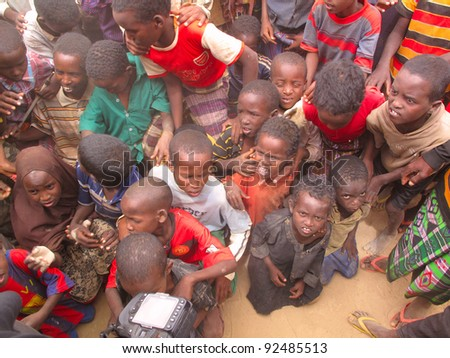 DADAAB, SOMALIA-AUGUST 15: unidentified children at the Dadaab refugee camp where thousands of Somalian wait for help because of hunger on August 15, 2011, in Dadaab,Somalia. - stock photo