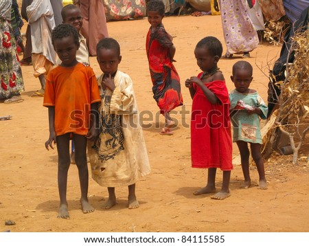 DADAAB, SOMALIA-AUGUST 15: Unidentified children live in the Dadaab refugee camp where thousands of Somalis wait for help because of hunger on August 15, 2011 in Dadaab, Somalia. - stock photo