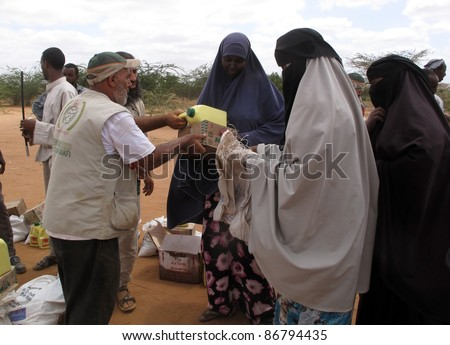 DADAAB, SOMALIA-AUGUST 15: Unidentified woman live in the Dadaab refugee camp where thousands of Somalis wait for help because of hunger on August 15, 2011 in Dadaab, Somalia. - stock photo