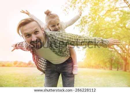 Daddy please, let's fly together - stock photo