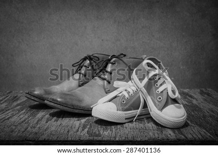 Daddy's boots and baby's sneakers, black and white
