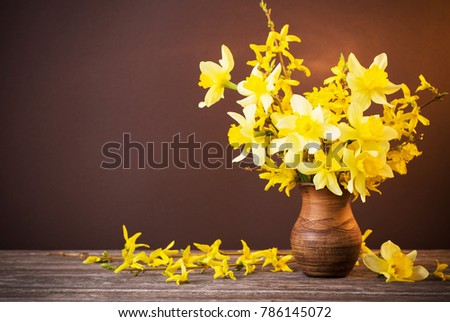 Daffodil Vase On Brown Background Stock Photo Royalty Free