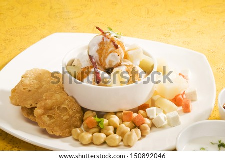 Dahi Bhalle Chaat or Stuffed Panipuri with Curd and Sweet Tamarind,Indian Dish - stock photo