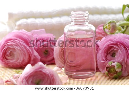 Dahlia flower and spa bottle on mat - stock photo